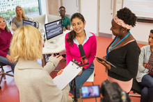 Community College Journalism Students At Microphone In Classroom