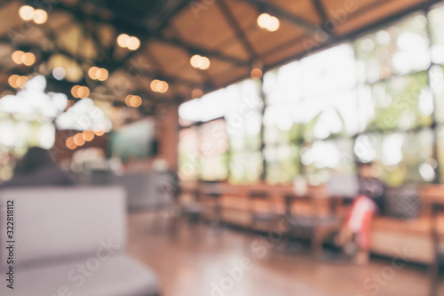 Cafe coffee shop interior abstract blur defocused with bokeh light background Canvas Print