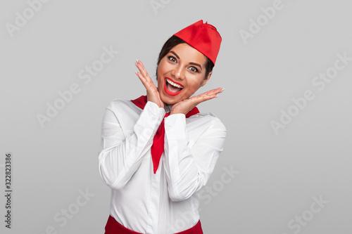 Excited flight attendant looking at camera Wallpaper Mural