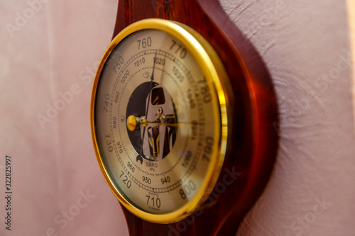 A vintage barometer Clock hangs on a pink wall. Canvas Print