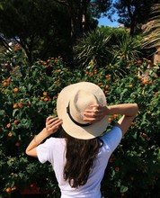 Rear View Of A Woman Standing In A Garden With Her Hand On Her Head, Amalfi Coast, Campania, Italy