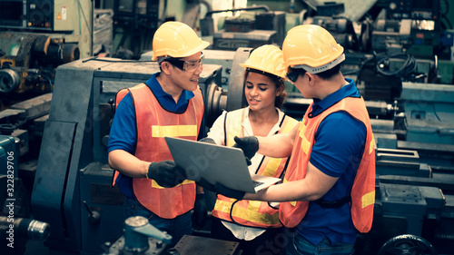 The scene of industrial inspectors team discussing using laptop checking the safety and review function in a metal factory, concept auditor safety, quality control in a factory, quality inspection Canvas Print