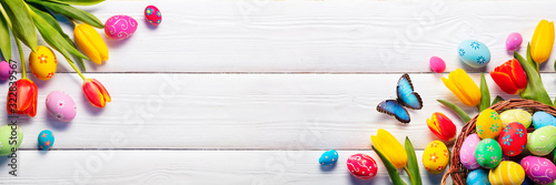Easter - Painted Eggs In Basket And Tulips On White Plank - 322839567