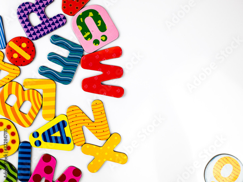 Colored letters amalgam in white background, top view, copy space Fototapet