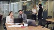 Slow motion of multiracial considerate young business colleagues which working under joint project in the meeting room using laptop and different reports