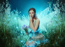 Art Photo Fantasy Pixie Butterfly. Young Fairy With Glow Wings Holds Bouquet Flower. Dark Blue Backdrop Fabolous Night Firefly Star Glitter Light. Fingers Show Sign Silence. Cute Face, Makeup Red Lips