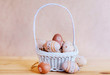 Beige Easter Eggs in a Small White Basket