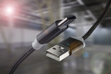 USB Cable And USB Type-C On An Industrial Background.