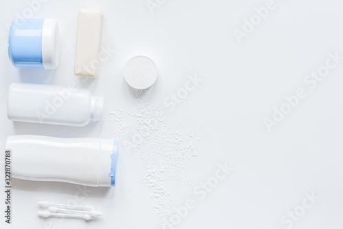 Fototapeta baby organic cosmetic for bath on white bakground top view obraz