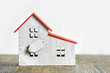 Model of a wooden house with a sign. Home sale purchase concept