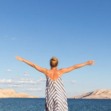 Happy Carefree Woman Rising Ar...