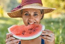 Beautiful Woman Eating Waterme...