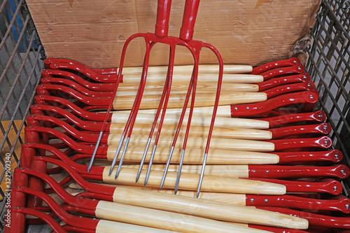 Fototapeta Steel forks piled up in the workshop