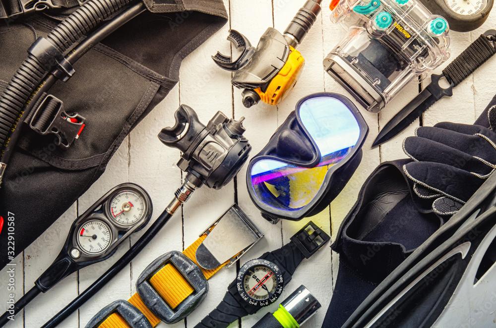 Fototapeta Full set of scuba diving equipment Fins, Regulator/Octopus, Depth Gauge, Balanced Regulator,Power Inflator, Dive Mask and Snorkel , aqualung. Scuba gear and accessories.