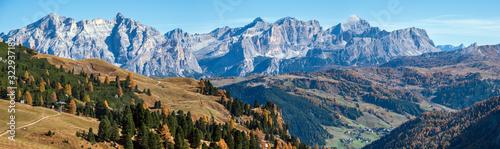 Fototapeta Autumn alpine Dolomites mountain scene, Sudtirol, Italy. Peaceful view near Gardena Pass. Picturesque traveling, seasonal, nature and countryside beauty concept scene. obraz