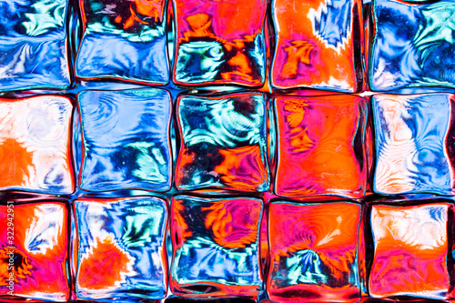 Fotografie, Obraz Abstract background of a colorful image distorted through a glass block wall