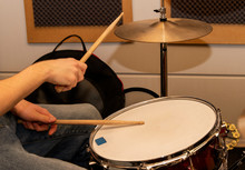 Hands Of A Man Playing A Drum Set.