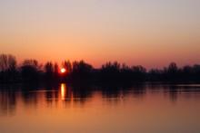 Sunrise Above A Lake In Arnhem Called: Rijkerswoerdse Plassen In The Netherlands