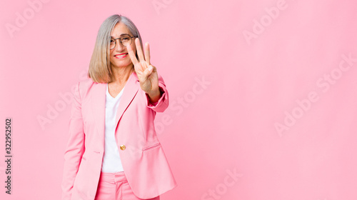 middle age cool woman smiling and looking friendly, showing number three or thir Wallpaper Mural