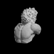 Plaster Bust Of Laocoon On A Black Background