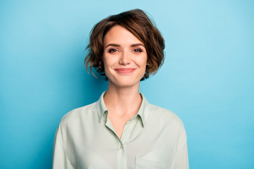 Closeup photo of attractive cute business lady short bob hairstyle smiling good mood responsible person wear casual formalwear green shirt isolated blue color background