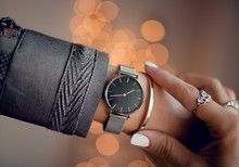 Stylish Black Watch With Silver Strap On Woman Hand