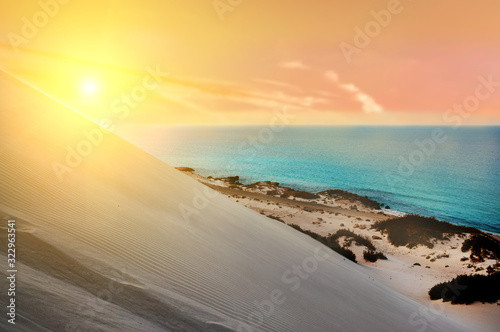 Top view from a sand dune on the coast of the Indian Ocean at sunset Canvas Print