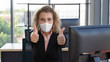 canvas print picture - caucasian businesswoman with medical mask for coronavirus covid-19 protection working in office and thumb up showing support to wearing mask