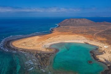 The Isla de Lobos in Fuerteventura, Spain with the Playa de la Concha. Aerial drone shot in october 2019