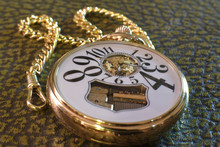 An Old Gold Pocket Watch With ...
