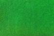 Nahaufnahme von grünem Teppich für den Außenbereich, der künstlichen Rasen imitiert