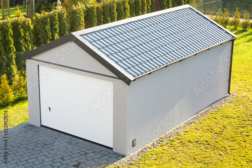 Fototapeta Installation of a new garage with metal elements in the garden obraz