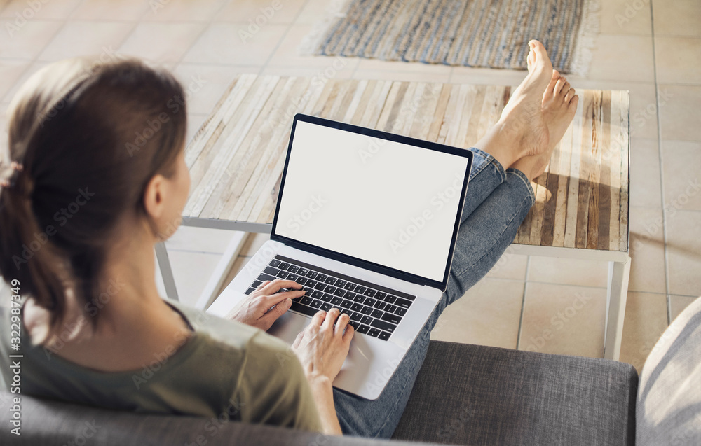 Young woman using laptop computer at home. Freelance, student lifestyle, education, technology and online shopping concept - obrazy, fototapety, plakaty