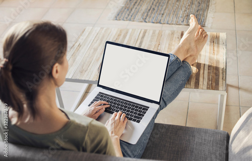 Fototapeta Young woman using laptop computer at home. Freelance, student lifestyle, education, technology and online shopping concept obraz