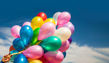 Multi-colored Balloons On Blue...
