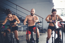 Three People Training Indoor G...