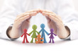 canvas print picture - Family insurance concept with colorful family figurines covered by hands