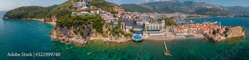 Obraz Aerial view of Mogren beach (two sandy beaches) and the old city (stari grad) of Budva. Montenegro. Jagged coast on the Adriatic Sea - fototapety do salonu