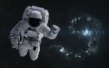 Astronaut On A Background Of Colliding Blue Galaxies. Science Fiction. Elements Of This Image Furnished By NASA