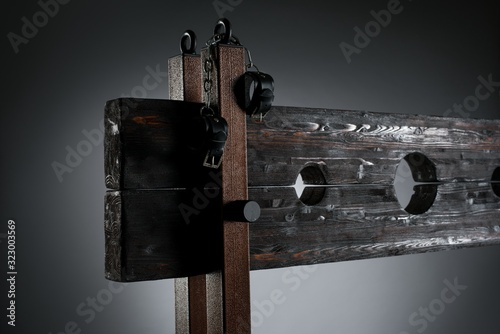 Handcuffs hanging on pillory for BDSM session Canvas Print