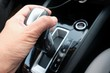 hand holding the gear shift to drive