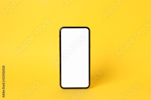 Fototapeta Phone with empty on yellow background, space for text obraz