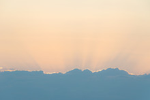 Cloud Edge And Sunset Light Behind Clouds
