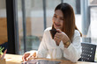 businesswoman having tea or coffee in home office