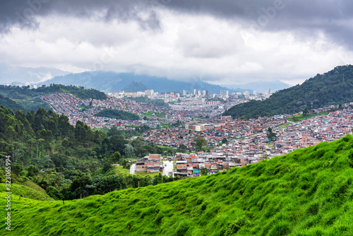 Panoramic view of foggy and misty mountains and highlands in the countryside of Colombia near Manizales in Caldas province, South America