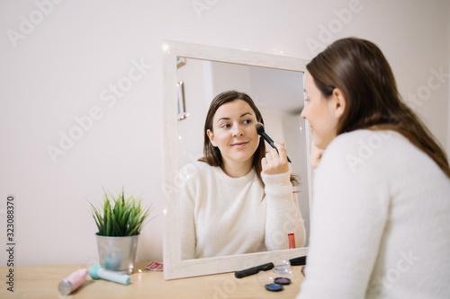 Fotografie, Obraz Happy woman makeup in front of a mirror