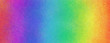 Rainbow color background in bright colorful red orange yellow green blue violet and purple colors and faint detailed textured pattern