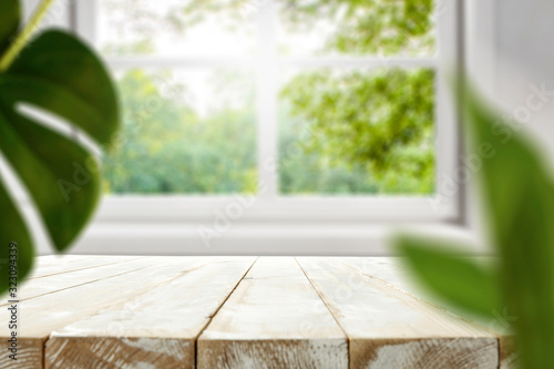 Fototapeta Table background of free space and spring window background  obraz