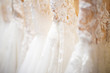 canvas print picture - Wedding dress close up at the wedding salon. Wedding dresses hanging on a hanger. Fashion look. Interior of bridal salon.