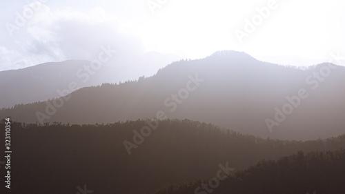 Fototapeta Foggy mountain peak landscape sun backlit obraz na płótnie